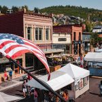 Main street of a small American town with the American Flag in the forefront